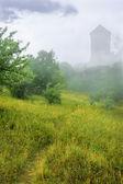 Fantasy tower in fog — Stock Photo