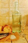 Bottle, wineglasses, bread and salt — Stock Photo