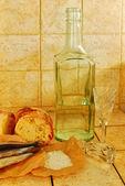 Bottle, wineglasses, bread and salt — Stock Photo