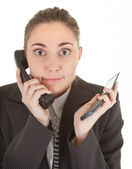 Emotional woman with a telephone — Stock Photo
