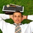 Relax positive businessman — Stock Photo