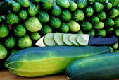 Oblong marrow and green cucumber — Stock Photo