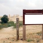 Blank wooden Signpost in the desert — Stock Photo