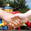 Children shaking hands — Stock Photo #3211140