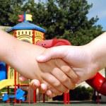 Children shaking hands — Stock Photo