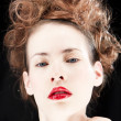 Stock Photo: Woman wearing red lipstick