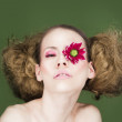 Woman with flower on eye — Stock Photo #2934205