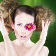 Woman with flower on eye — Stock Photo #2934207