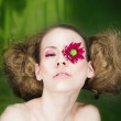 Woman with flower on eye — Stock Photo