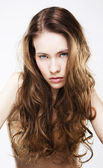 Portrait of long haired young woman — Stock Photo