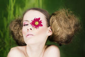 Woman with flower on eye — Stockfoto