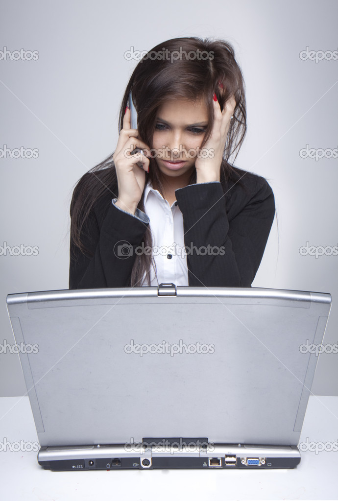 Unhappy woman having problems with computer trying to reach support line    — Stock Photo #2937036