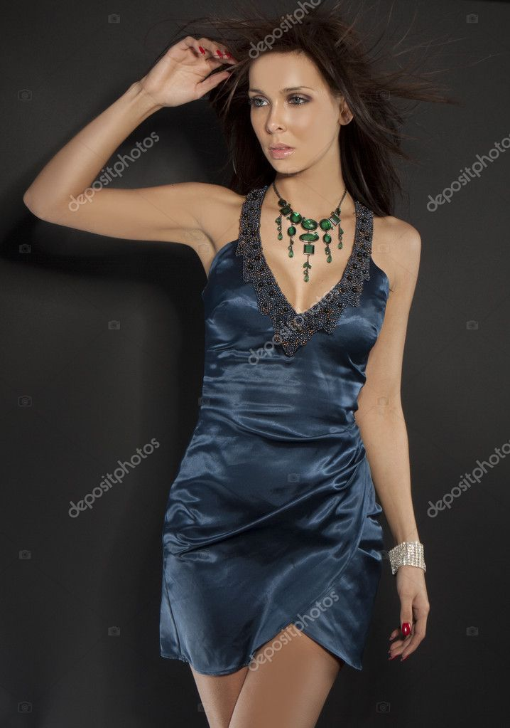 Studio portrait of a beautiful glamour model in a blue dress  — Stock Photo #2937208