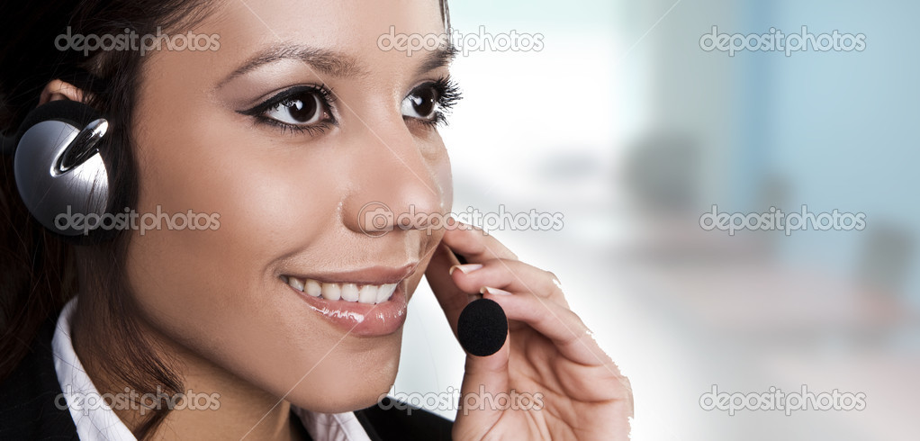 Closeup of a beautiful, young brunette woman with headset  Stock Photo #2979989