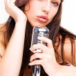 Royalty-Free Stock Photo: Sexy Girl singing in retro mic