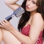 Sexy Girl singing in retro mic — Stock Photo