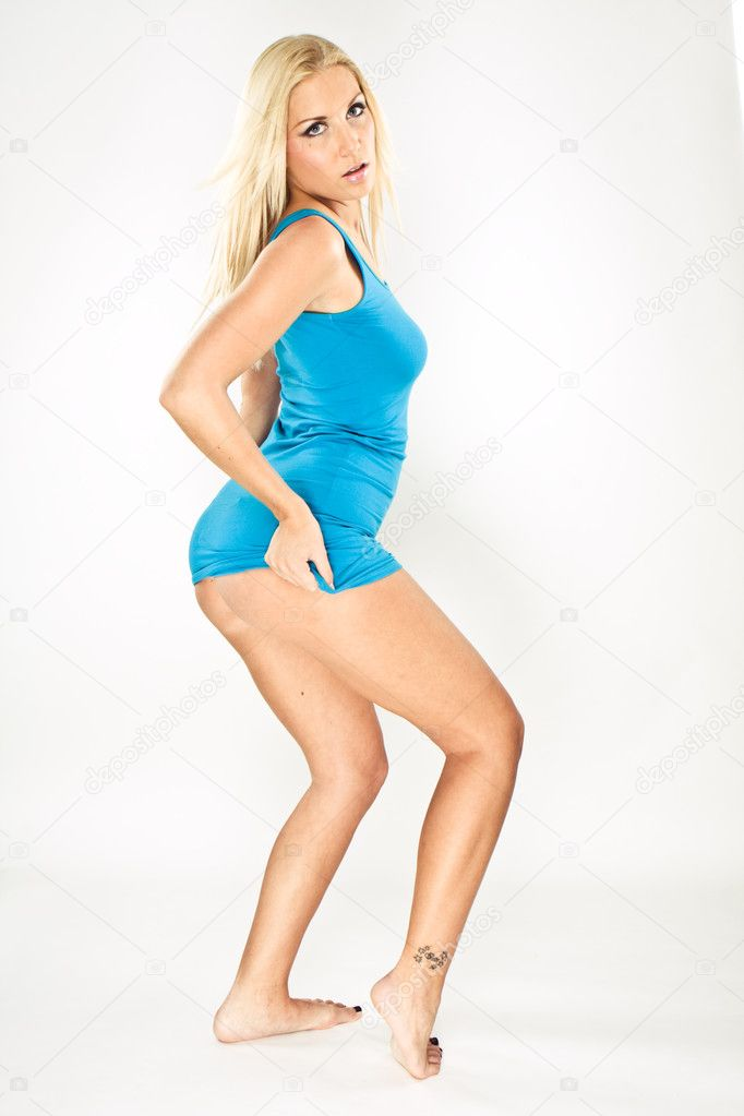 Blue top girl jumping isolated on white — Stock Photo #3020921