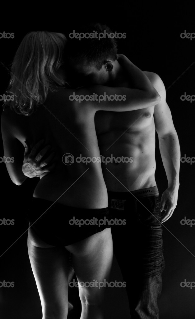 Sexy erotic couple black and white on black background