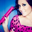 Stock Photo: Girl with pink straightener