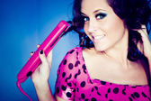 Girl with pink straightener — Stock Photo
