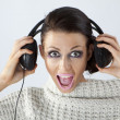 Stock Photo: A girl in headphones