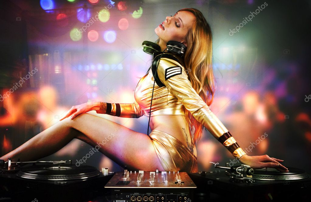  Beautiful DJ girl on decks on the party,   Stock Photo #3109611