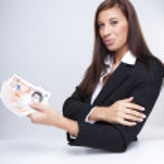 Businesswoman pulling money — Stock Photo