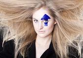 WINDBLOWN HAIR AND ARROW — Stock Photo