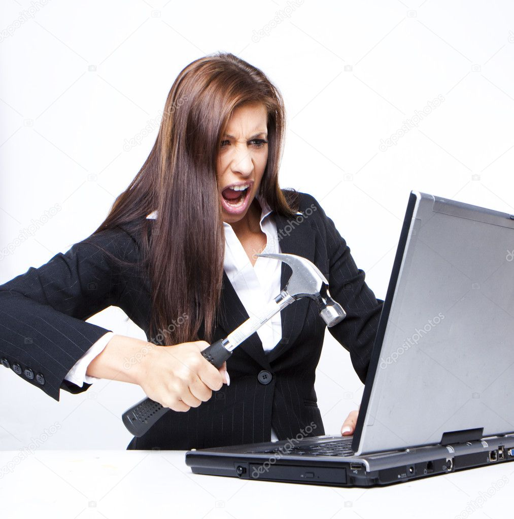 Angry business woman about to demolish her laptop with a hammer — Stock Photo #3225128