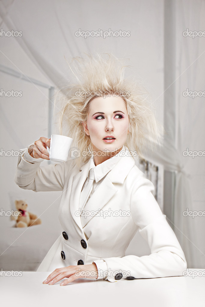 Crazy Business woman Woman sitting at the table drinking coffe in white outfit   Stock Photo #3225278