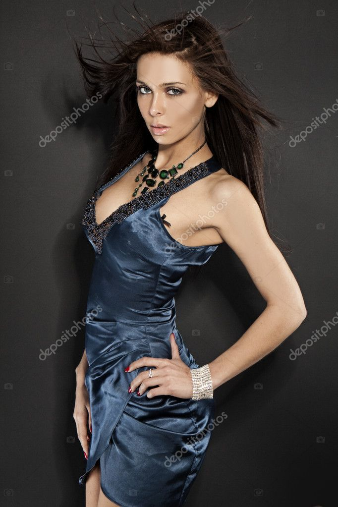Studio portrait of a beautiful glamour model in a blue dress  — Stock Photo #3691726