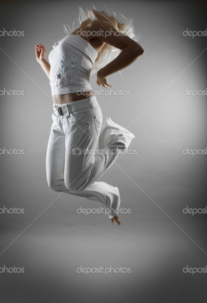 Stylish and cool looking breakdancer jumping  Stock Photo #3697553