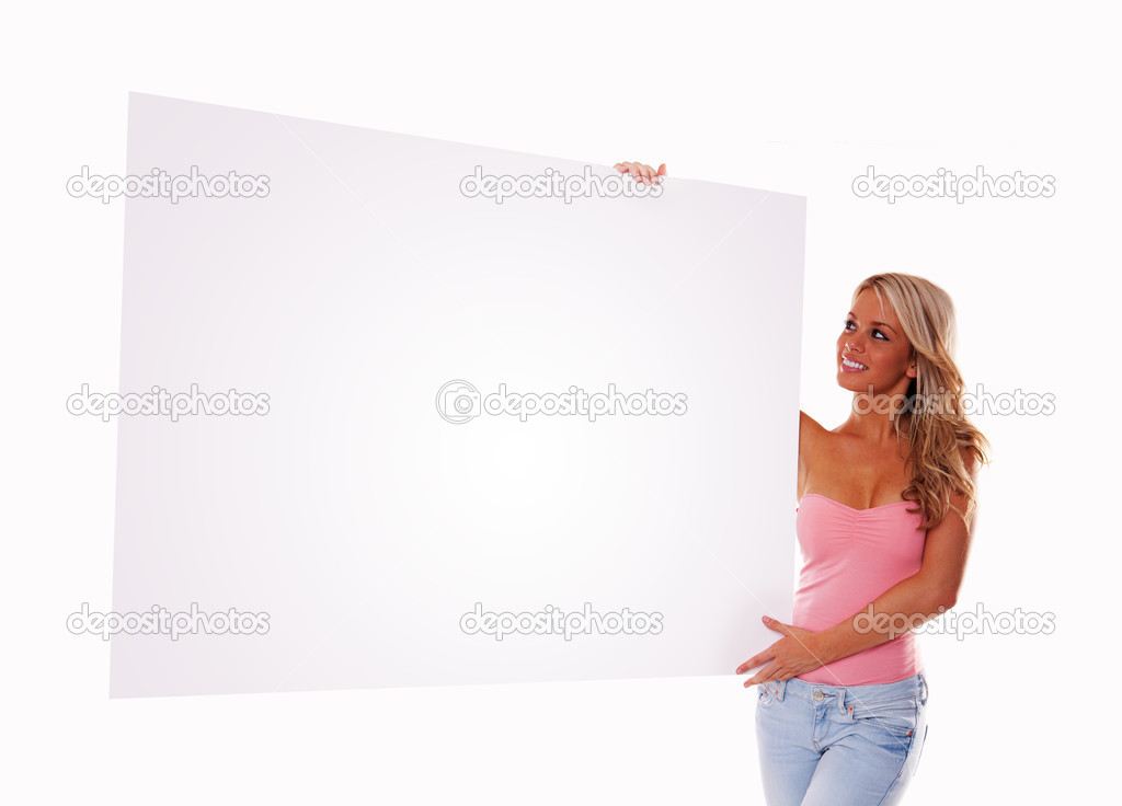 Sexy girl holding a billboard add isolated over a white background — Stock Photo #3746959
