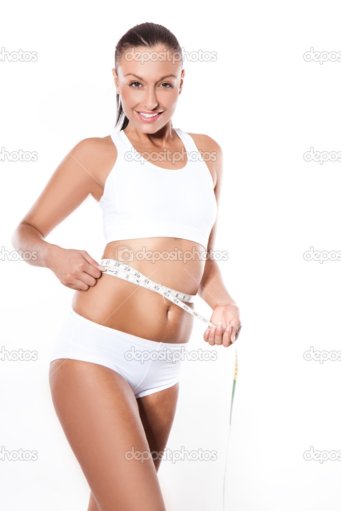 Young beautiful woman wearing lingerie with measure tape on white — Stock Photo #3800811