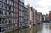 Amsterdam buildings and canal — Stock Photo