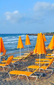 Sunbeds and beach umbrellas — Stock Photo