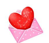 Coração vermelho em envelope cor de rosa — Fotografia Stock