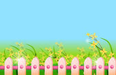 Fence in front of green lawn and flower — Stock Photo