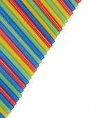 Multicolored cocktail straws like a rainbow. — Stock Photo