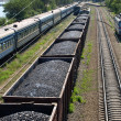 Freight train with coal and passenger train. — Stock Photo #3365769