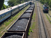 Freight train with coal and passenger train. — Stock Photo
