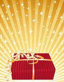 Cadeau rouge sur fond doré. — Vecteur