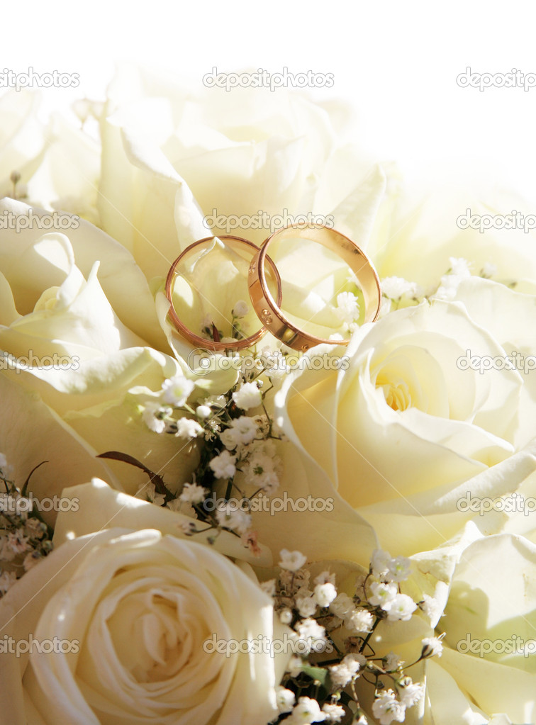 Wedding rings and roses can use as background  Stock Photo #2864616