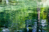 A water background with reflections — Stock Photo