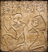 Egyptian hieroglyphs and human figures — Stock Photo