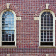 Three windows and a door in brick wall - Stok fotoraf