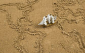 Ship on sand wit global map outline — Stock Photo