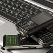 Black keyboard and mobile phone — Stock Photo