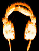 Burning headphones — Stock Photo