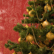 Christmas tree in red grunge background — Stock Photo